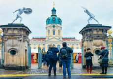 Berlin, Germany - December 9, 2017: People with backpack taking photos at Christmas Market at Charlottenburg Palace in Winter. Berlin, Germany. Advent Fair stock image