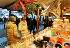 Berlin, Germany - December 9, 2017: People buying Glass Christmas Candles at Night Market on Gendarmenmarkt in Winter Berlin,. Germany. Advent Fair and Bazaar stock image