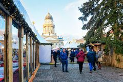 Berlin, Germany - December 8, 2017: People on Christmas Market at Gendarmenmarkt of Winter Berlin, Germany. Advent Fair Decoration. And Stalls with Crafts Items royalty free stock image