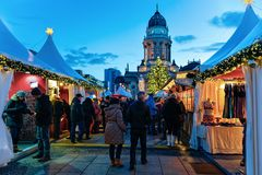 Berlin, Germany - December 8, 2017: People on Christmas Market at the Gendarmenmarkt of Winter Berlin, Germany. Advent Fair. Decoration and Stalls with Crafts royalty free stock photo