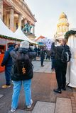Berlin, Germany - December 8, 2017: People on Christmas Market at Gendarmenmarkt of Winter Berlin, Germany. Advent Fair Decoration. And the Stalls with Crafts stock image