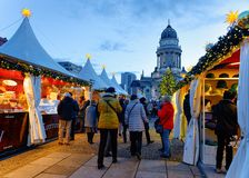 Berlin, Germany - December 8, 2017: People on Christmas Market at Gendarmenmarkt of Winter Berlin, Germany. Advent Fair Decoration. And Stalls with Crafts Items royalty free stock images