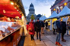 Berlin, Germany - December 8, 2017: People on Christmas Market at Gendarmenmarkt of Winter Berlin, Germany. Advent Fair Decoration. And Stalls with Crafts Items stock image