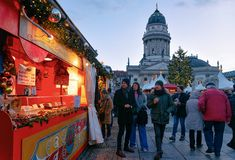 Berlin, Germany - December 8, 2017: People on Christmas Market at Gendarmenmarkt of Winter Berlin, Germany. Advent Fair Decoration. And Stalls with the Crafts stock photography