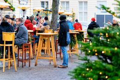 Berlin, Germany - December 9, 2017: People at Christmas Market street cafe on Charlottenburg Palace in Winter Berlin, Germany. Advent Fair Decoration and stock image