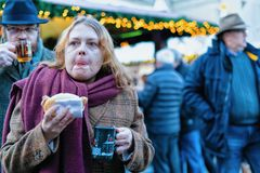 Berlin, Germany - December 8, 2017: People eating Food at Night Christmas Market at Gendarmenmarkt in Winter Berlin, Germany. Advent Fair Decoration and Stalls stock photos
