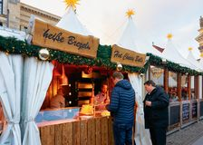 Berlin, Germany - December 8, 2017: People at food Stalls in Night Christmas Market on Gendarmenmarkt in Winter Berlin of Germany. Advent Fair Decoration and royalty free stock image