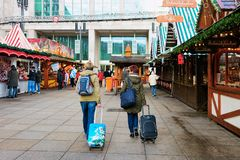 Berlin, Germany - December 10, 2017: People with luggage bags and backpacks on Christmas Market at Alexanderplatz in Winter Berlin. Germany. Advent Fair stock photo