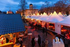 Berlin, Germany - December 9, 2017: People at Night Christmas Market at Charlottenburg Palace at Winter Berlin, Germany. Advent. Fair Decoration and Stalls with royalty free stock photography