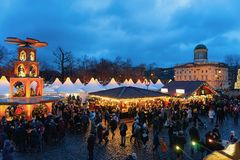 Berlin, Germany - December 9, 2017: People at Night Christmas Market in Charlottenburg Palace at Winter Berlin, Germany. Advent. Fair Decoration and Stalls with stock images