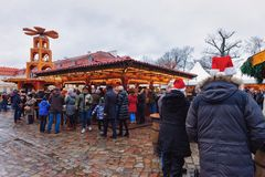 Berlin, Germany - December 9, 2017: People wearing Santa hats at Christmas Market in Charlottenburg Palace at Winter Berlin,. Germany. Advent Fair Decoration stock image