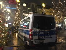 Police truck guarding a Christmas market in Berlin. Berlin, Germany - December 3, 2017: police van guarding a Christmas market in the Zoo district, near the site Royalty Free Stock Image