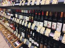 Wine bottles on supermarket shelf. Berlin, Germany - December 2, 2017: Wine bottles on a supermarket shelf. Many brands are recognizable Royalty Free Stock Photography