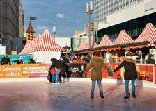 Berlin, Germany - December 10, 2017: Young girls on Skating rink on Christmas Market on Alexanderplatz in Winter Berlin, Germany. Advent Fair Decoration and royalty free stock image