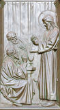 BERLIN, GERMANY, FEBRUARY - 14, 2017: The bronze relief of Supper of Jesus with the Disciples at Emamus on the gate of Dom. By Otto Lessing 1906 Royalty Free Stock Image