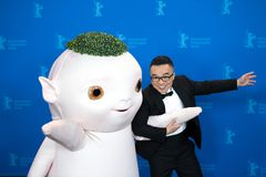 Director Raman Hui and `Buba Monster` pose during Berlinale 2018 Royalty Free Stock Photography