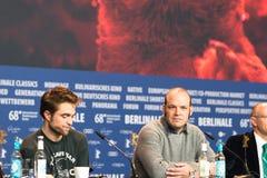 Robert Pattinson and Nathan Zellner at Berlinale 2018. Berlin, Germany - February 16, 2018: English actor Robert Pattinson and Nathan Zellner attend the `Damsel Royalty Free Stock Photography