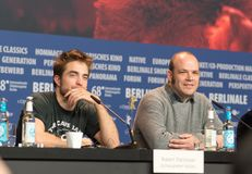 Robert Pattinson and Nathan Zellner at Berlinale 2018. Berlin, Germany - February 16, 2018: English actor Robert Pattinson and Nathan Zellner attend the `Damsel Royalty Free Stock Image