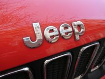 Jeep logo on red car