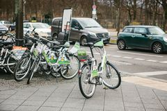 Berlin, Germany 15 February 2018: Rent a Bicycle to move around the city. An eco-friendly and popular means of. Transportation in the city for locals and Royalty Free Stock Photo