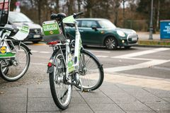 Berlin, Germany 15 February 2018: Rent a Bicycle to move around the city. An eco-friendly and popular means of. Transportation in the city for locals and Royalty Free Stock Photos