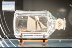 Sailing boat model inside bottle at German Museum of Technology. Berlin, Germany - February 2018: Sailing ship model inside bottle at German Museum of Technology stock photo