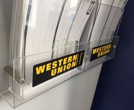 Western Union sign. Berlin, Germany - February 2, 2018: Western Union sign. The Western Union Company is an American financial services and communications royalty free stock photos