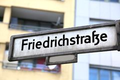 Berlin. Germany. Indication of the street  called friedrich stra. Berlin. Germany. Indication of the street in the center of the city called friedrich strasse Royalty Free Stock Photography