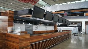 BERLIN, GERMANY - JAN 17th, 2015: Inside of the Berlin Brandenburg Airport BER, still under construction, check-in. Counter at the empty terminal building Stock Photo