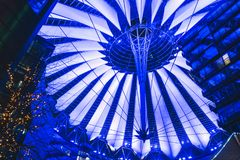 Roof of Sony Center in Berlin. Berlin, Germany - January 13, 2018: Futuristic roof of Sony Center on Potsdamer platz in Berlin illuminated at night Royalty Free Stock Photography