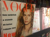 Vogue magazine for sale. Berlin, Germany - January 27, 2018: newsstand interior, cover pages of Vogue, the American fashion and lifestyle magazine displayed for stock photo
