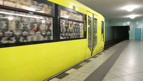 BERLIN, GERMANY - 28 JANUARY 2015: Underground railway U-bahn train coming to station and commuters walking in and out. stock video