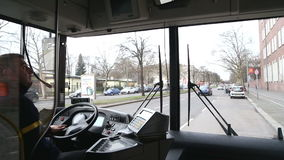 BERLIN, GERMANY - 28 JANUARY 2015: View from inside of a moving bus with driver and Berlin traffic on the way to Tegel airport. stock video