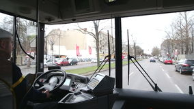 BERLIN, GERMANY - 28 JANUARY 2015: View from inside of a moving bus with driver and Berlin traffic on the way to Tegel airport. stock video footage