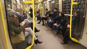 BERLIN, GERMANY - 28 JANUARY 2015: View of passengers sitting on seats in the U-Bahn wagon and it jolt and turns. stock video