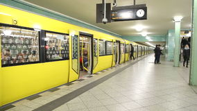 BERLIN, GERMANY - 28 JANUARY 2015: Yellow underground railway U-bahn stopped at station waiting for passengers to get in and doors. Finally close stock video