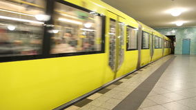 BERLIN, GERMANY - 28 JANUARY 2015: Yellow underground railway U-bahn train coming into station in Berlin. stock video footage