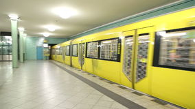 BERLIN, GERMANY - 28 JANUARY 2015: Yellow underground railway U-bahn train leaving station and camera follows the train into tunne stock video