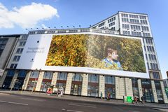 BERLIN, GERMANY - JULY 24, 2016: Apple iPhone ads on a city buil. Ding facade. Apple is a worldwide tech company stock photography
