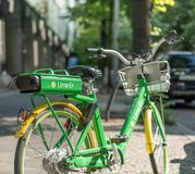 Close up of a Lime-E electric bike on a sidewalk in Berlin, Germany royalty free stock image