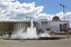 Fountain in the center of the Lustgarten park on the Museum Island. Berlin, Germany - July 01, 2018: Fountain in the center of the Lustgarten park on the Museum Royalty Free Stock Images