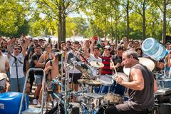 Many people in crowded Park Mauerpark watching street perform royalty free stock photography