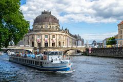 Berlin / Germany - 1 July 2018: Tourist boat passing in front of Bode Museum, located on Museum Island, on Spree river. Berlin / Germany - 1 July 2018: Tourist stock photo