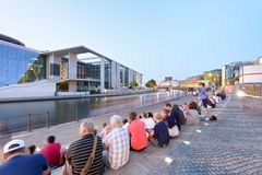 BERLIN, GERMANY - JULY 24, 2016: Tourists along Spree river at n Royalty Free Stock Photo