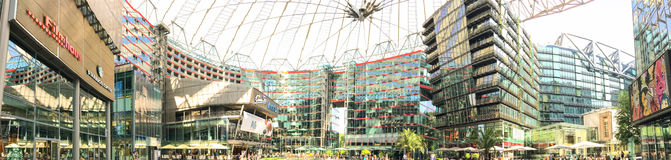 BERLIN, GERMANY - JULY 2016: Tourists visit Potsdamer Platz. Ber. Lin attracts 10 million people annually stock image