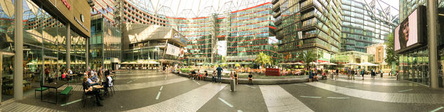 BERLIN, GERMANY - JULY 2016: Tourists visit Potsdamer Platz. Ber. Lin attracts 10 million people annually royalty free stock photo