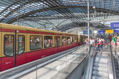 BERLIN, GERMANY - JULY 25: Unknown commuters are traveling by train at the central station of Berlin on July 25, 2013 in the centr Royalty Free Stock Images