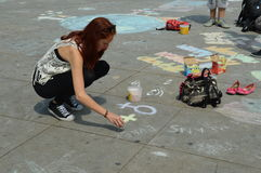 Berlin, Germany - July 2015 - young female street artist Royalty Free Stock Images