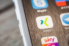 Close up to Xing app on iPhone 7 screen. BERLIN, GERMANY - JUNE 6, 2018: Close up to Xing professional network app on the screen of an iPhone 7 Plus with Stock Images
