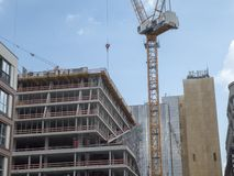 Cranes in Berlin city centre. Berlin, Germany - June 5, 2018: Cranes and buildings under construction stock photos